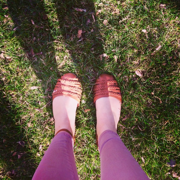 Basic Bitch feet in grass photo. :) Springy/strappy sandals!