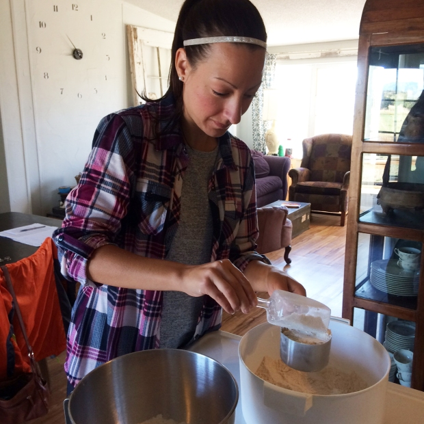 me-scooping-the-flour-at-the-goat-cheese-lady-farm