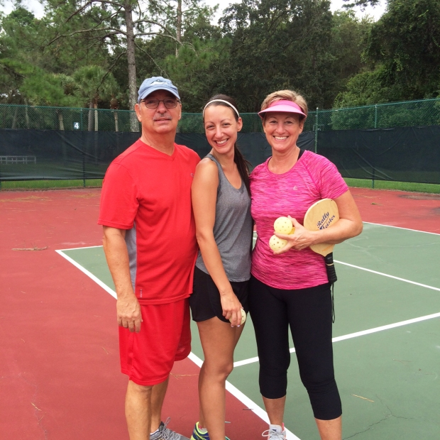 mom-dad-and-me-playing-pickleball