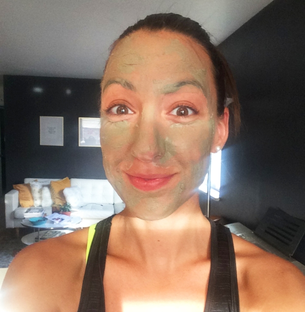 My goofy face in Matte + Juliette betonite clay face mud mask, spa day at home after a run