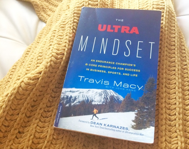reading-the-ultra-mindset-and-charging-my-garmin-gps-watch-before-a-long-run