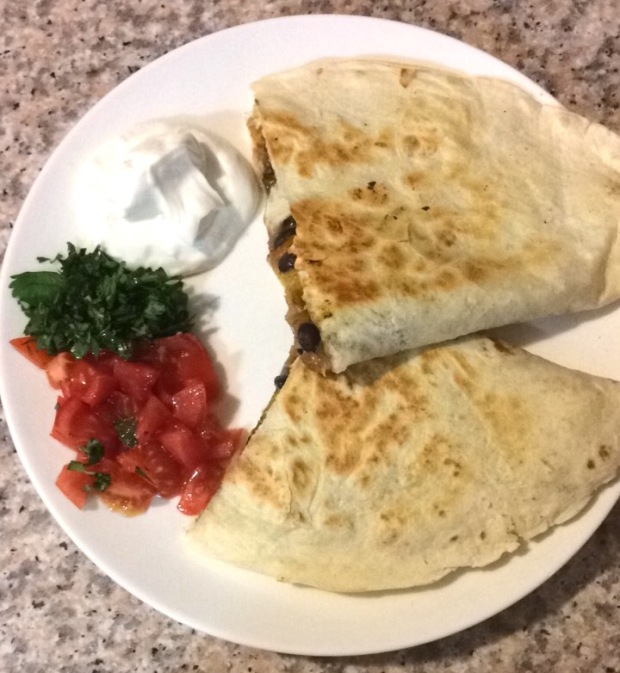 Butternut squash, black bean, and red onion quesadilla with greek yogurt sour cream